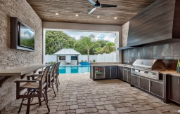 Outdoor kitchen with grill area and sunken bar florida